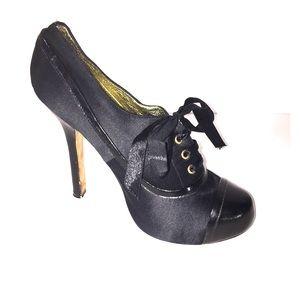 bebe Black satin upper leather outter sole heels 8
